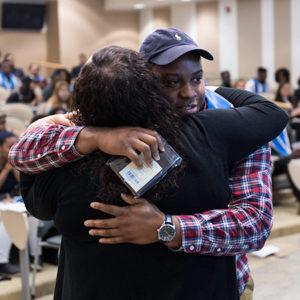 Student hugging parent