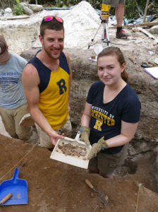 Students show bones, shell, and ceramics from the 17th century