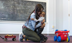 Laianna and her son, Corey, are pictured hugging and smiling