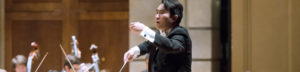 music conductor conducting an orchestra