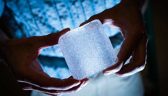 two hands holding a block of ice