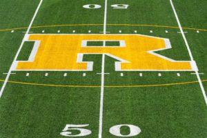 UR Athletics R on the 50 yard line of fauver stadium