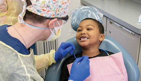 dentist working on small child in chair